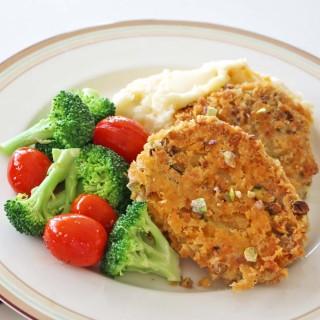 Cheesy Pistachio Pork Tenderloin with Grilled Broccoli and Grape Tomatoes